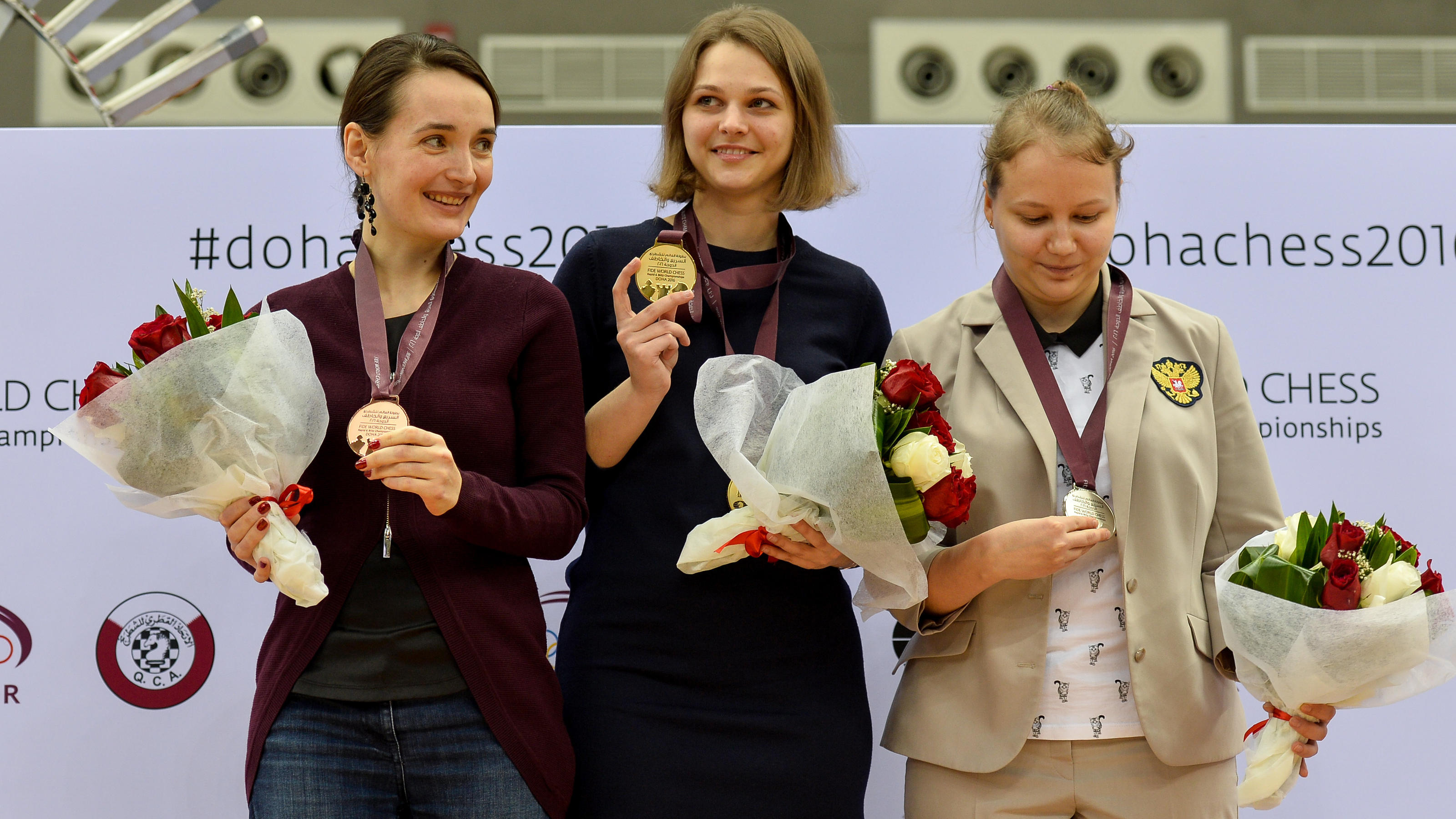 DOHA Dec. 31 2016 ()- Bronze medalist Kateryna Lagno of Russia gold medalist Anna Muzychuk of Ukraine and silver medalist Valentina Gunina of Russia pose on the podium at the medal ceremony for the Women's Blitz Champio