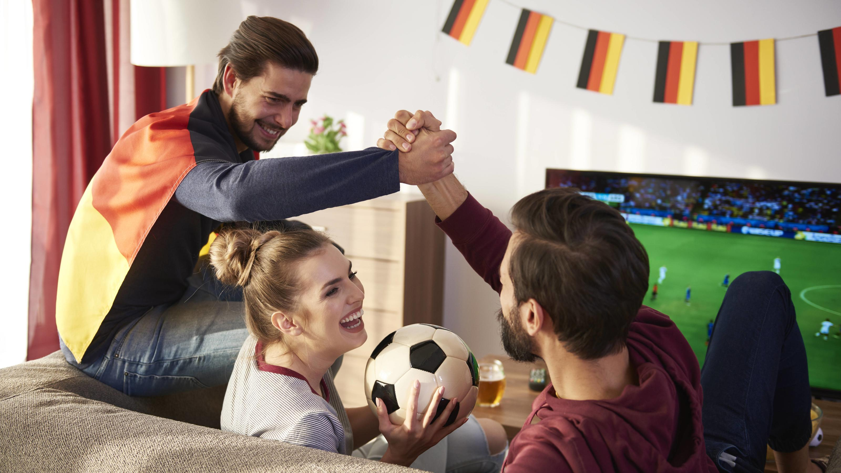 German football fans watching Tv and cheering model released Symbolfoto property released PUBLICATIONxINxGERxSUIxAUTxHUNxONLY ABIF00083