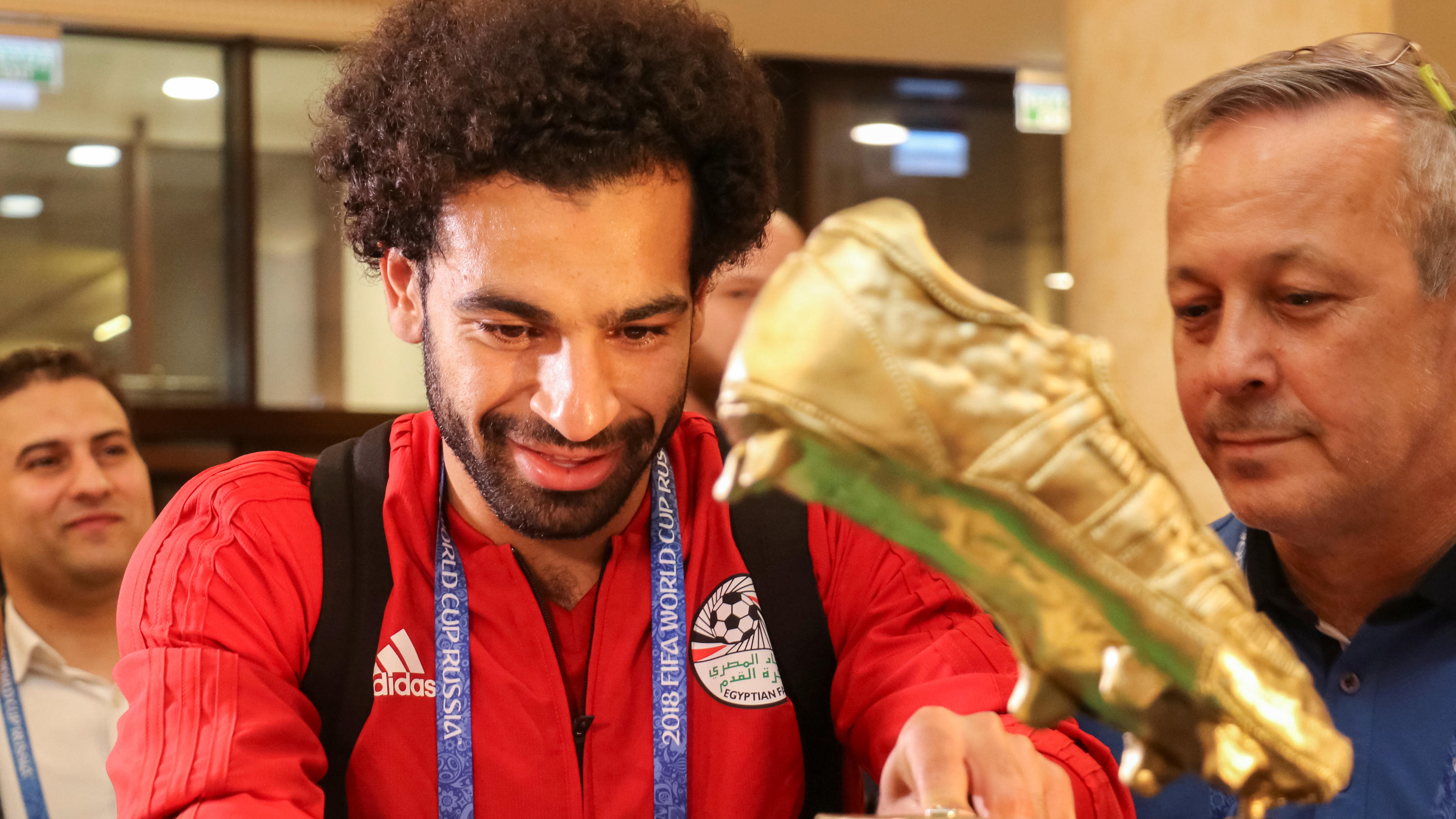 Player of the Egyptian national soccer team Mohamed Salah receives a cake, weighing 100 kilograms and decorated with a golden football boot, as a present on his birthday during a ceremony in the Chechen capital Grozny, Russia June 16, 2018. REUTERS/A