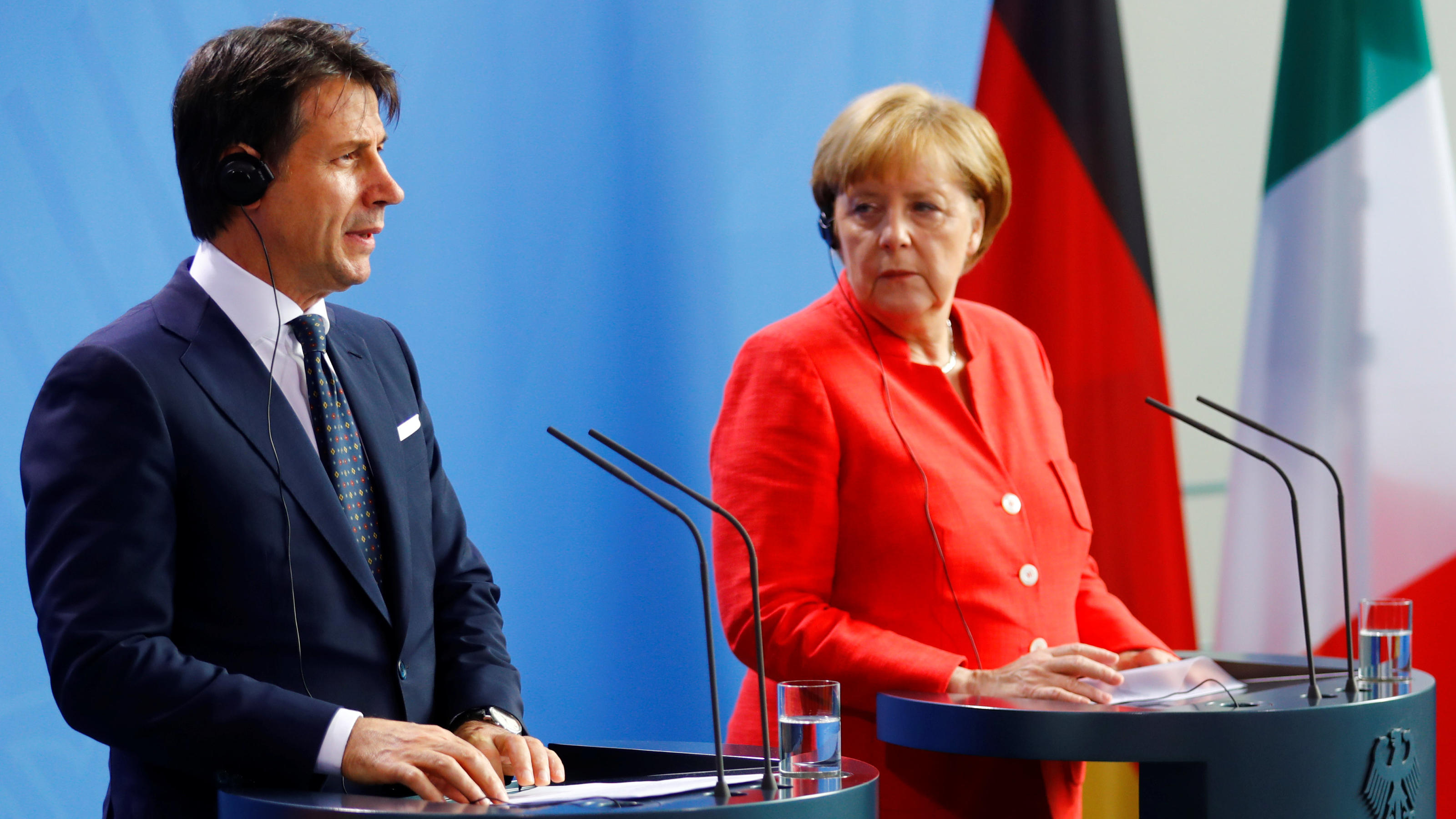 German Chancellor Angela Merkel and Italian Prime Minister Giuseppe Conte hold a news conference at the chancellery in Berlin, Germany, June 18, 2018. REUTERS/Hannibal Hanschke