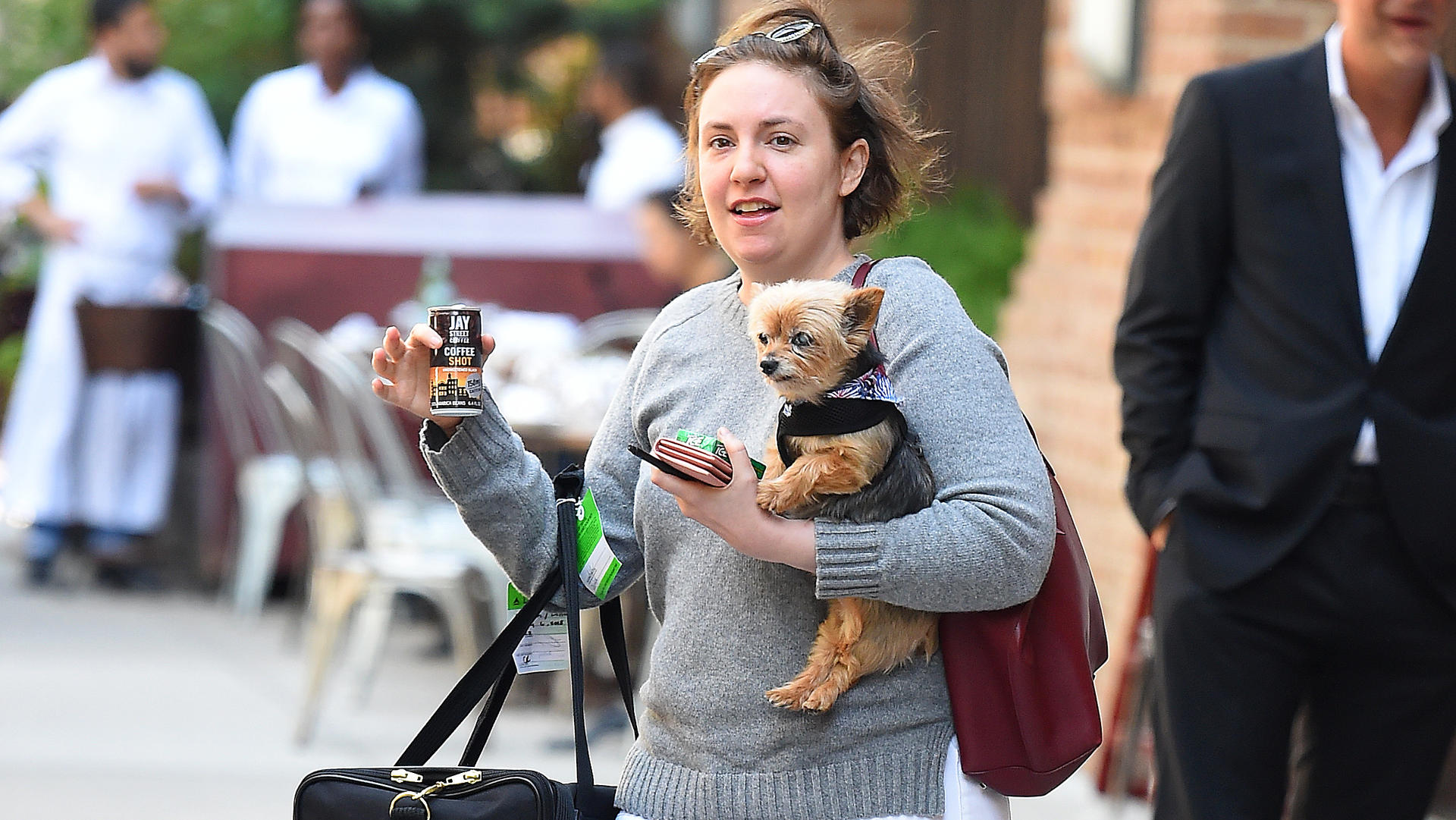 Lena Dunham holds a dog in New York CityPictured: Lena DunhamRef: SPL5008899 090718 NON-EXCLUSIVEPicture by: Robert O'neil / SplashNews.comSplash News and PicturesLos Angeles: 310-821-2666New York: 212-619-2666London: 0207 644 7656Milan: +39 02 4399