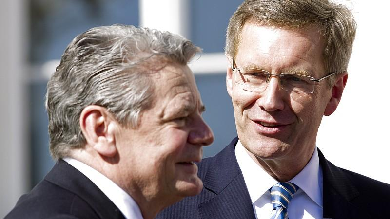 Former German President Christian Wulff (R) talks with President-in-waiting Joachim Gauck outside Bellevue Castle in Berlin, March 19, 2012. Gauck, a former Lutheran pastor and human rights activist from communist East Germany, was elected president