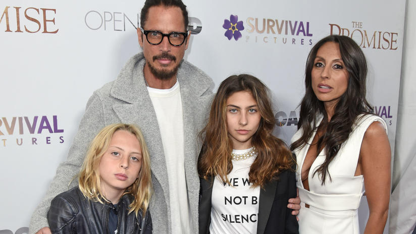 File Photos- The rocker, who was found hanged in his hotel room earlier this week, looked happy as he appeared with wife Vicky and children Toni and Christopher at the event on April 18th. The prolific songwriter had written a song for the movie abou