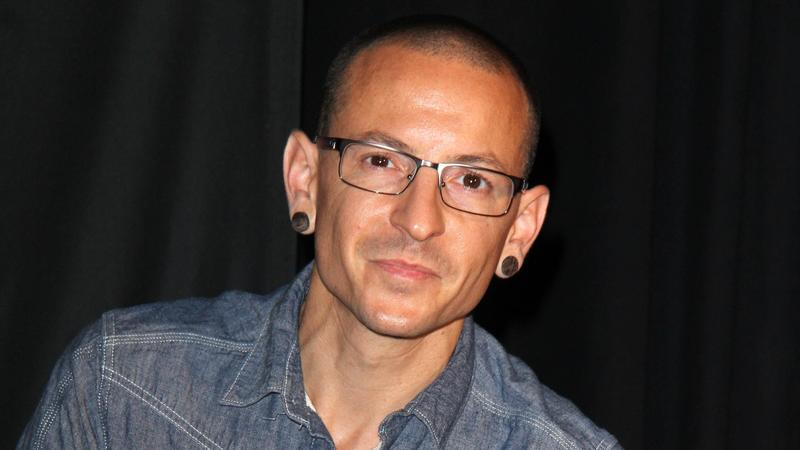 LOS ANGELES, CA - June 18: Chester Bennington at the ceremony inducting Linkin Park into the Guitar Center's Rockwalk, Guitar Center, Los Angeles,  June 18, 2014. Credit: Janice Ogata/MediaPunch |
