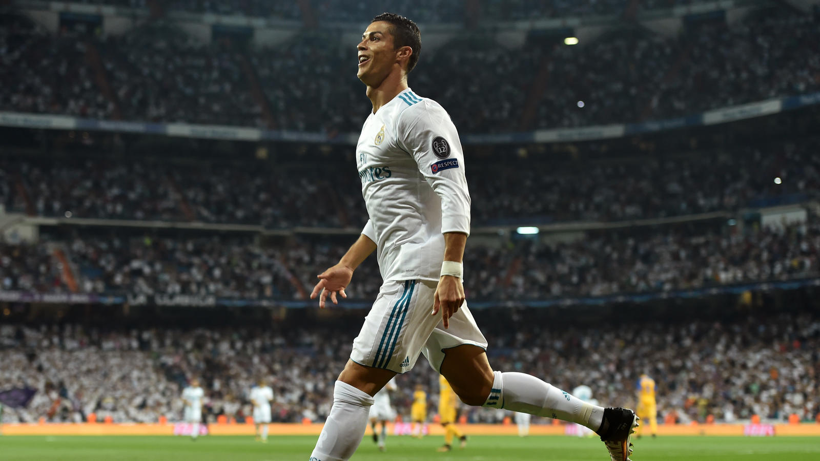 MADRID, SPAIN - SEPTEMBER 13: Cristiano Ronaldo of Real Madrid celebrates scoring his sides first goal during the UEFA Champions League group H match between Real Madrid and APOEL Nikosia at Estadio Santiago Bernabeu on September 13, 2017 in Madrid,