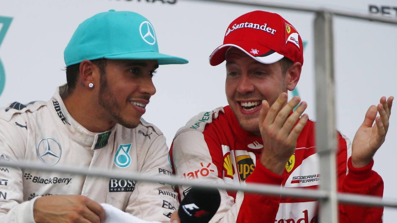 Sepang International Circuit, Sepang, Kuala Lumpur, Malaysia. Sunday 29 March 2015. Lewis Hamilton, Mercedes AMG, 2nd Position, and Sebastian Vettel, Ferrari, 1st Position, talk on the podium. World _ONZ0647 PUBLICATIONxINxGERxSUIxAUTxHUNxONLYSepang