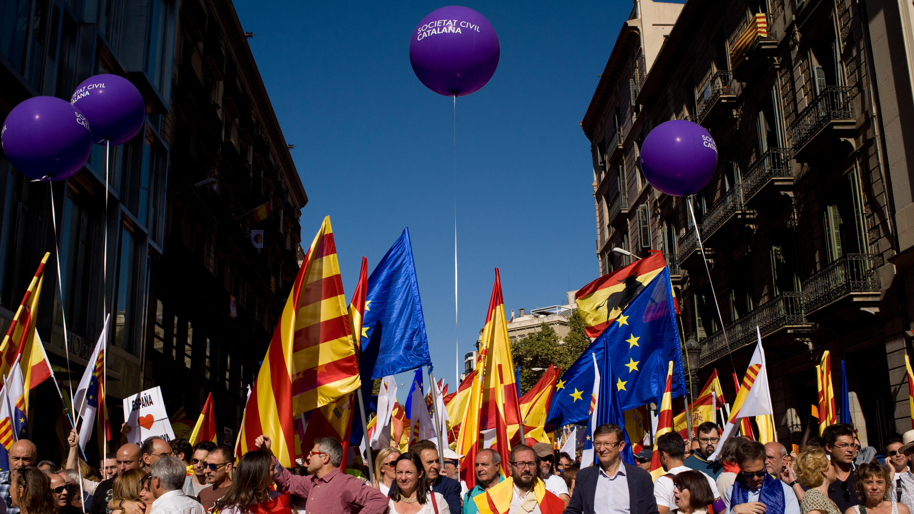 Anti-separatists demonstrators gather in Barcelona against Catalan government and for the unity of Spain. Two days before that Catalan president Carles Puigdemont will appear to the Catalonian parliament to discuss on the results of the referendum th