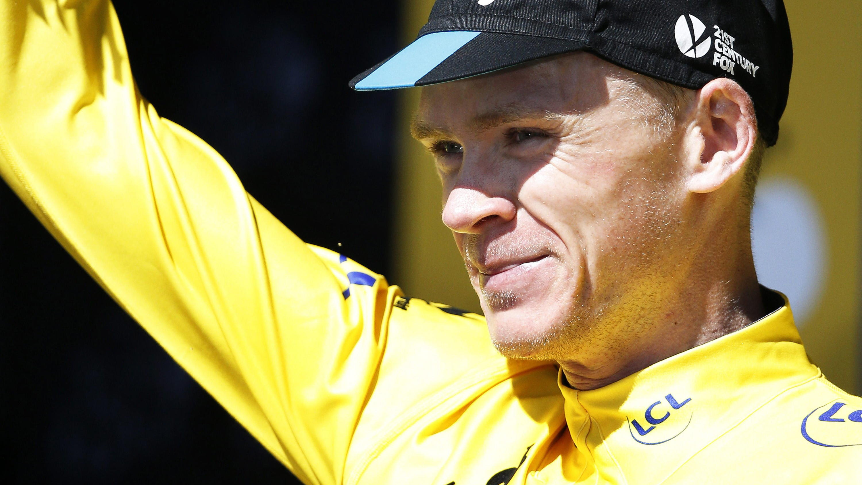 epa04841132 Team Sky rider Christopher Froome of Britain reacts on the podium wearing the overall leader's yellow jersey following the 7th stage of the 102nd edition of the Tour de France 2015 cycling race over 190.5km between Livarot and Fougeres, F