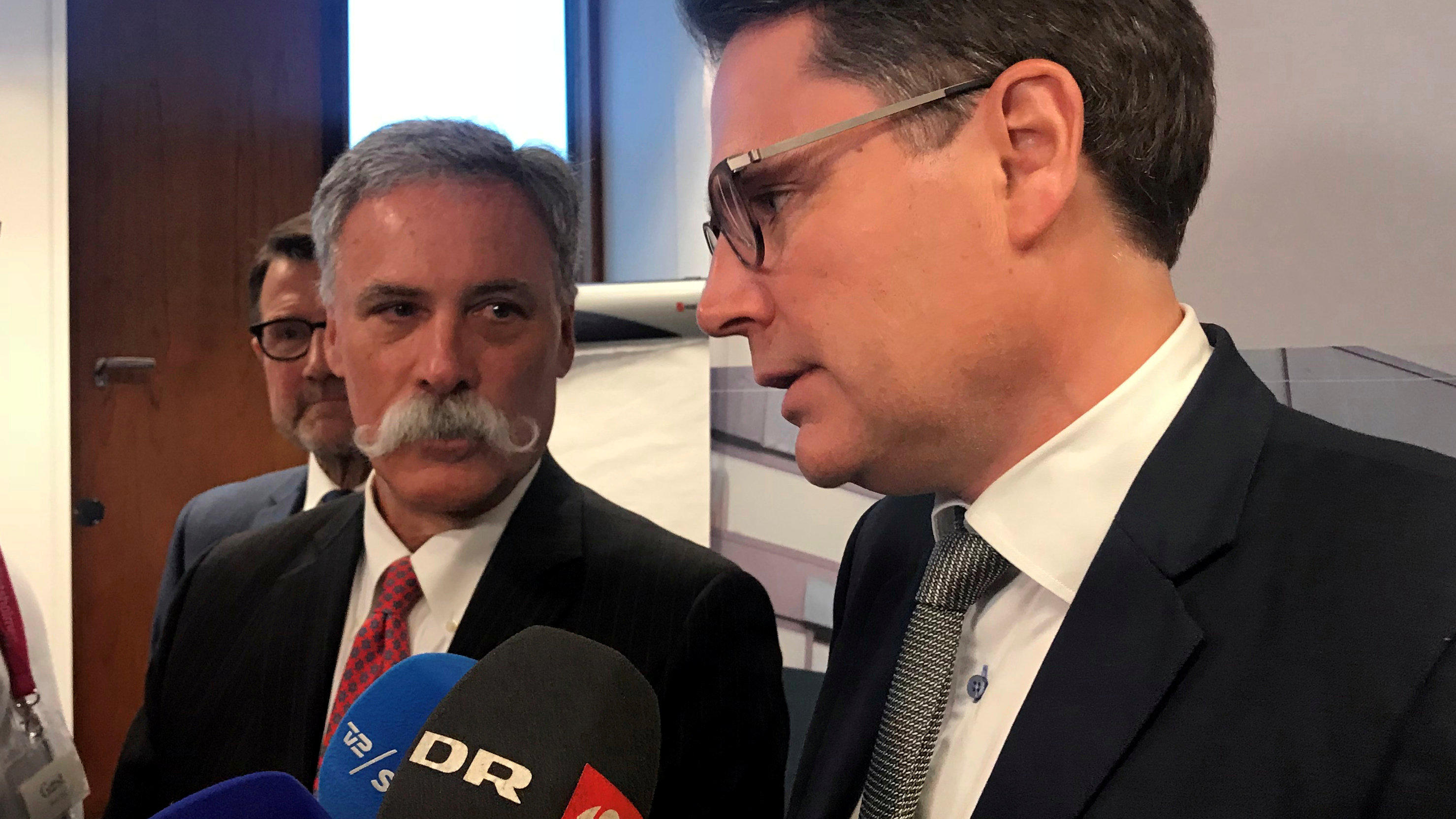 Formula One chief executive Chase Carey (L) and Denmark's Minister for Industry, Business and Financial Affairs Brian Mikkelsen speak to media in Copenhagen, Denmark January 10, 2018. REUTERS/Stine Jacobsen