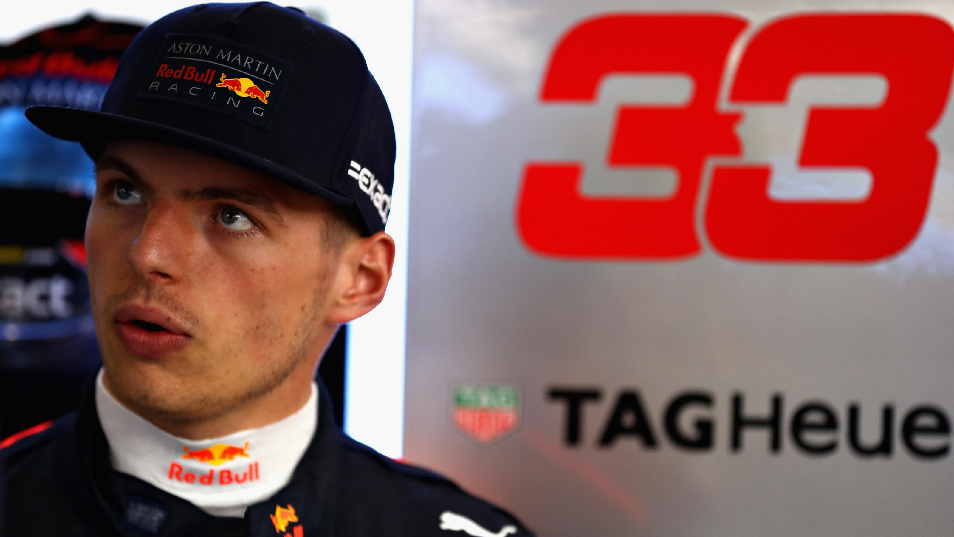 SHANGHAI, CHINA - APRIL 14: Max Verstappen of Netherlands and Red Bull Racing looks on in the garage during qualifying for the Formula One Grand Prix of China at Shanghai International Circuit on April 14, 2018 in Shanghai, China.  (Photo by Mark Tho